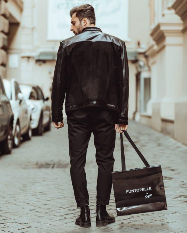 man wearing a black leather jacket