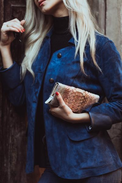 Blond Girl with a a blue leather jacket